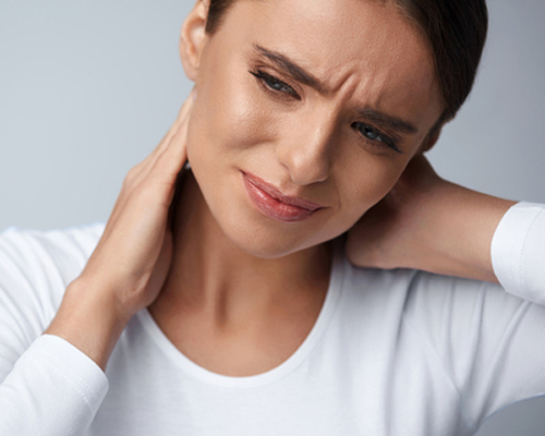 Young woman experiencing chronic pains