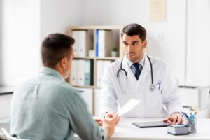Doctor talking to patient about why he feels being sober sucks