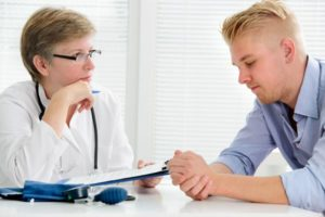 Doctor telling a patient about the addictive nature of Tramadol