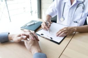 Doctor with a patient discussing drug rehab in New Jersey