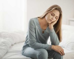 Woman suffering from opioid withdrawal