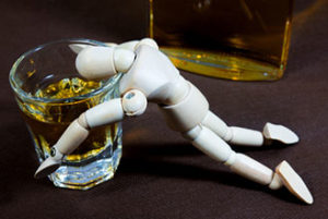 Small manakin drowning in alcohol